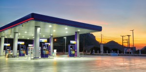 A Petrol Station With A Sunset Behind It