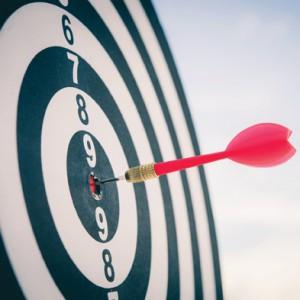 Dart Board With A Dart In The Bullseye