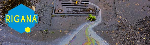 Petrol Oil Running Down A Gutter Drain